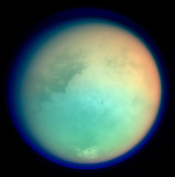 This is a false colour image of Saturn's moon, Titan. It's assembled from 4 images from the Casinni probe. The colours in the image represent infrared (red and green) and ultraviolet (blue). This elegantly demonstrated how some wavelengths are more opaque than others and how this changes due to atmospheric composition. The red and green colours show areas where methane in the atmosphere is absorbing IR radiation and the blue shows the height of the atmosphere and detached hazes. Image Credit: NASA/JPL/Space Science Institute.